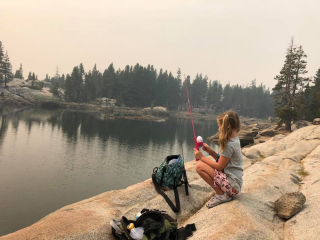 Eva fishing at the lake 2018