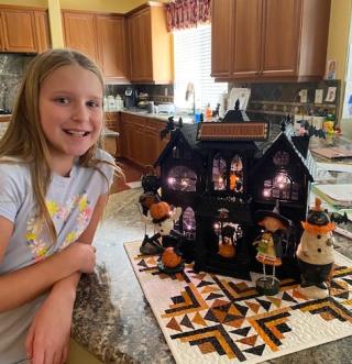 Eva with halloween house